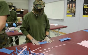 Aerial Delivery instructors, students make face coverings, surgical masks