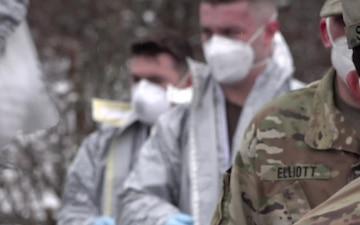 Massachusetts National Guardsmen decontaminate
