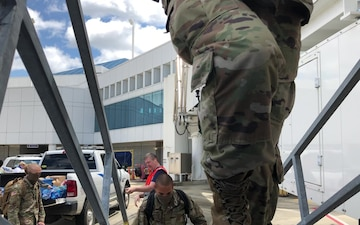 First Soldiers from Fort Jackson board a plane to AIT