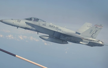 F/A-18C Hornets with VMFA-115 refuel with VMGR-152