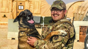 Joint Efforts Lead to Life-Saving Transport and Treatment of Military Working Dog