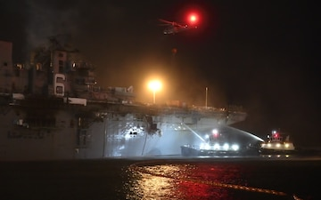 Sailors and federal San Diego firefighters fight fire aboard USS Bonhomme Richard