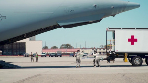 B-Roll: COVID-19 patient arrives at Travis AFB during first Indo-Pacific aeromedical evacuation mission