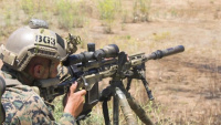 Marines engage targets during Scout Sniper Course