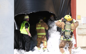 Edwards AFB firefighters conduct search and rescue training during foam test