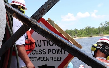 Norfolk District navigation support installs SAV oyster reef signage