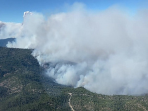 146th Airlift Wing C-130 MAFFS (Modular Airborne Fire Fighting System) aircraft suppress wildfires in California