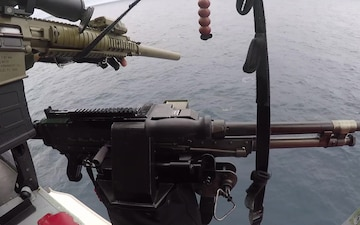 A deployed helicopter interdiction tactical squadron team attached to Coast Guard Cutter Hamilton fires three warning shots across the bow of the drug vessel, July 21, 2020, Caribbean Sea. The law enforcement phase of counter-smuggling operations in the Eastern Pacific Ocean is conducted under the authority of the Coast Guard 11th District, headquartered in Alameda, California, and the law enforcement phase of operations in the Caribbean is conducted under the authority of the Coast Guard 7th District, headquartered in Miami. (U.S. Coast Guard video)
