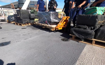 The Coast Guard Cutter Hamilton (WMSL 753) crew offloads approximately 11,500 pounds of cocaine and approximately 17,000 pounds of marijuana, Aug. 27, 2020, Port Everglades, Florida. The drugs were interdicted by crews from Coast Guard Cutter Resolute (WMEC 620), Cutter Hamilton and USS Shamal (PC 13), USS Nitze (DDG 94), while on patrol in the eastern Pacific Ocean from suspected drug smuggling vessels. (U.S. Coast Guard video by Chief Petty Officer Charly Hengen and Petty Officer 3rd Class Brandon Murray)