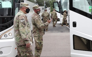 36th Infantry Division Headquarters Soldiers Load the Buses to Deploy