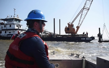 Coast Guard construction tender works in Sabine Pass post Hurricane Delta