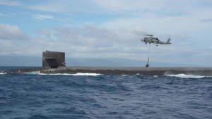 MH-60R Sea Hawk Delivers Payload to USS Henry M. Jackson