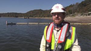 Floating barge with air curtain burner incinerates Lake Cumberland debris