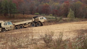 Fort McCoy RTS-Maintenance Wheeled Vehicle Recovery Course Training: Winching out a mired vehicle, Part I