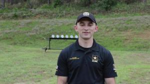 U.S. Army Marksmanship Unit Action Shooting Team member Spc. Dexter Bradley gives a Veteran's Day greeting.