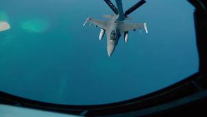KC-135R Stratotanker refuels F-16C Fighting Falcon and F-15E Strike Eagle