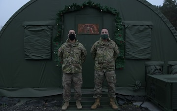Alaska Army National Guard Capt. Anthony Montoya and Sergeant 1st Class Wayne Chaput wish their friends and family a Happy Holiday.