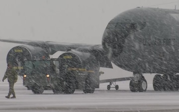 Maintainers move KC-135 in Iowa snow