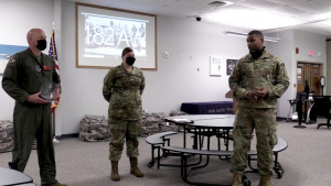 Wing commander awards 2020 Outstanding Airman of the Year trophies at workcenters