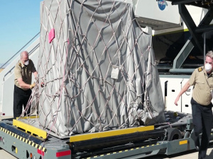 Aircraft carrying supplies for emergency field hospital lands at Plant 42