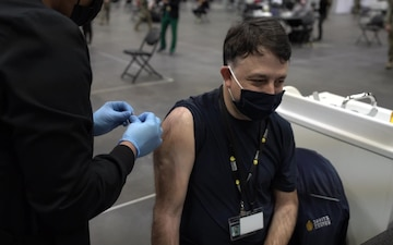 Staff workers at the Javits NY vaccination site receive the vaccine