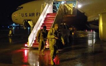 Utah National Guard Soldiers de-board a KC-135 Stratotanker