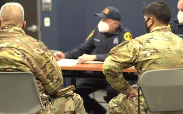 Hawaii National Guard Soldiers meet with Virginia State Police to finalize traffic security operations during the 59th Presidential Inauguration