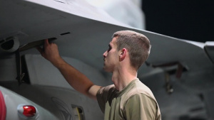 380th EAMXS perform maintenance on F-16s