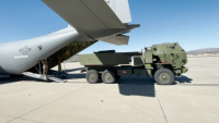 Marines, airmen work together to transport HIMARS