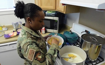 Cooking African American cultural foods with Senior Airman Stewart