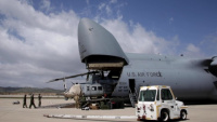 Marines, airmen load helicopters into Super Galaxy for deployment