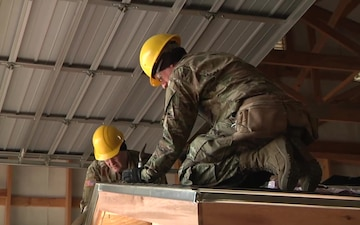 102d Training Division instructors help students hone carpentry and masonry skills in 12 W course