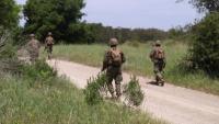 Defense in depth: IMC Marines patrol defensive positions during Week 12