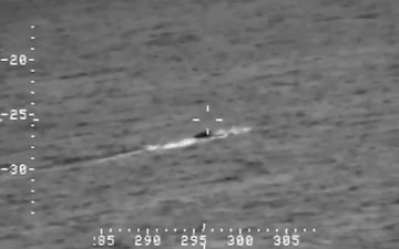 An AMO P-3 crew tracks a low profile smuggling vessel- second video.