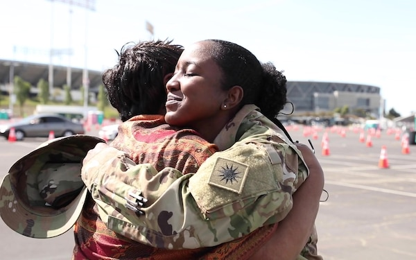 Cal Guard Soldier and mother celebrate reunion with COVID-19 vaccination