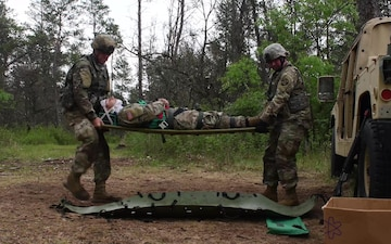 Maj. Stacy Black, an Army Reserve Medical Service Corps Officer, discusses the Expert Field Medical Badge event at Fort McCoy