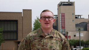 Senior Airman Logan Burdett gives a Father's Day