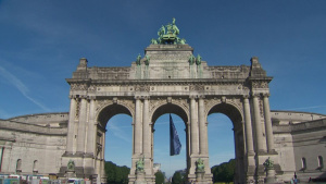 NATO flag flies under the Cinquantenaire Arch in Brussels