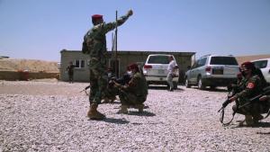 Peshmerga female soldiers run through squad movement drills