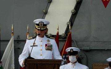 Capt. Walt M. Slaughter and Capt. Amy N. Bauernschmidt read their orders