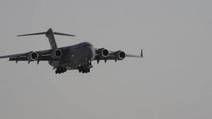 Afghan Evacuees deplane at Al Udeid