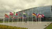 Flags fly at half-staff at NATO Headquarters to commemorate the 20th anniversary of the 2001 terrorist attacks