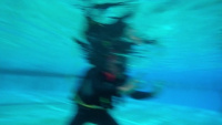 Service members are introduced to scuba gear