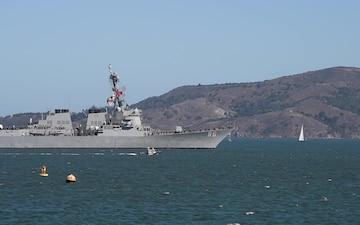 U.S. Navy and Coast Guard ships transit under the Golden Gate Bridge