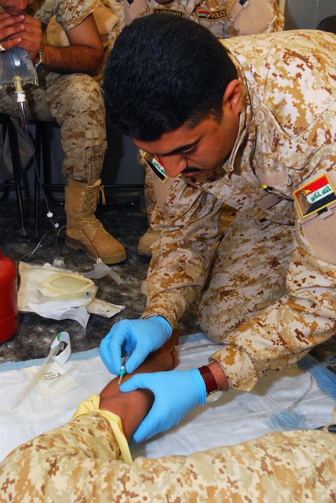 Iraqi police graduate medic training at Forward Operating Base Delta