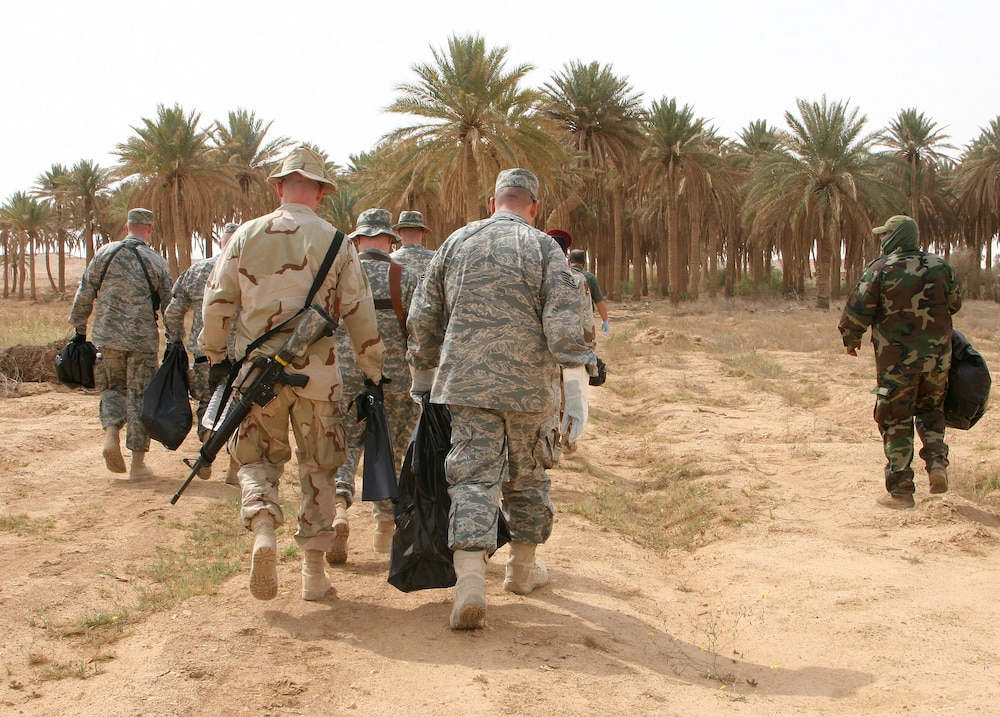 Iraqi and U.S. service members unite to restore historic sight.