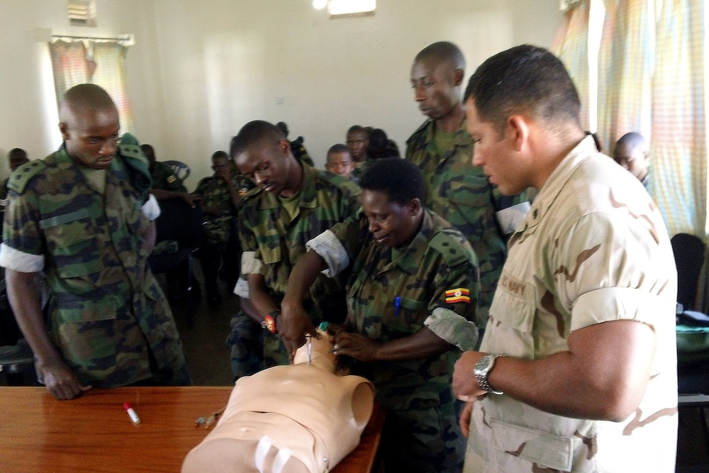 US military medical providers, back to basics with Ugandan counterparts