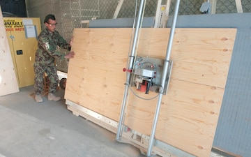 Afghan National Army leads the way wielding screw guns and welding torches