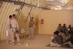 Marine advisors take an over-the-shoulder approach to training the Afghan police