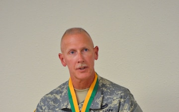 Command Sgt. Major Kurtis J. Timmer awarded the Order of the Marechaussee